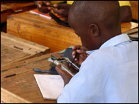School child using E-slate, EduVision