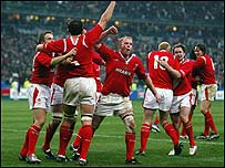 Welsh players celebrate victory over France