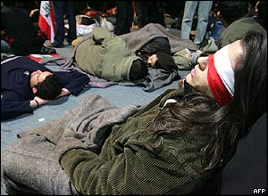Lebanese opposition supporters sleep ahead of an anti-Syria rally