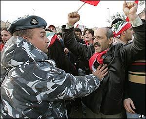 Beirut protestor waving a Lebanese flag