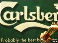 Carlsberg being drunk against advertising backdrop