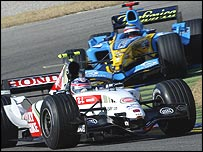 BAR-Honda's Takuma Sato and Renault's Fernando Alonso in pre-season testing