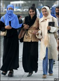 Afghan girls make their way through the streets of Kabul