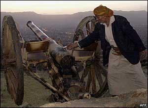 Yemeni man prepares to fire the Ramadan cannon at sunset on Noqum mountain overlooking the capital, Sanaa.