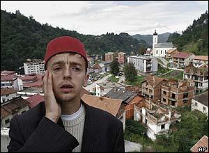 Bosnian Muslim Imam, Idriz Halilovic, says noon prayer from atop the White Mosque in Srebrenica
