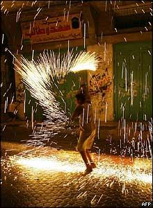 Palestinian boy lets off fireworks in Shati refugee camp, Gaza city