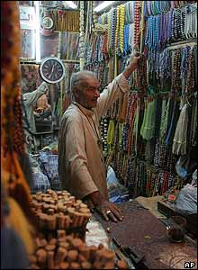 Iraqi shopkeeper sells prayer beads in Baghdad