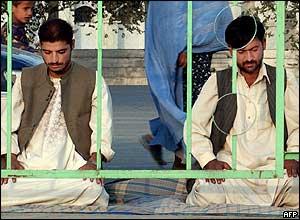 Afghan men pray in Kabul