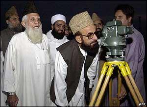 Chairman of the Pakistan Central Ruet-e-Hilal Committee, Mufti Muneeb-ur-Rehman, looks through binoculars in order to sight the moon in Peshawar