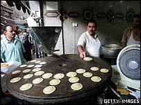 Preparing Qatayef sweets for Ramadan