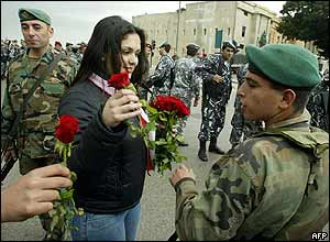 Pro-opposition protester distributes roses to Lebanese security forces