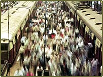 Commuters alight from trains in Mumbai