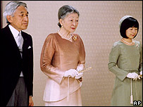 Emperor Akihito, left, Empress Michiko, centre, and their daughter Princess Sayako stand together as they listen to Imperial Household Agency grand steward reporting the message