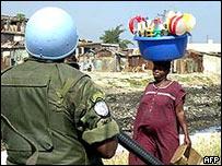 A UN peacekeeper patrols a slum in Haiti
