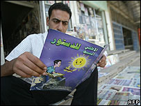 Iraqi reading pamphlet supporting new constitution