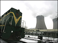 A train passes the giant cooling towers of a power station on February 17, 2005 in Beijing, China