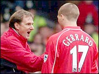 Former Liverpool assistant boss Phil Thompson makes a point to Steve Gerrard