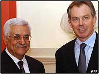 Palestinian leader Mahmoud Abbas shakes hands with British Prime Minister Tony Blair