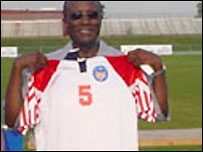 Winston Tubman holds up a football shirt (Copyright: www.supportersofwinstonatubman.org)