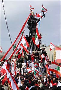 Picture from reader Tony Wright showing protesters flying flags on the statue in Martyrs' Square, Beirut, Lebanon