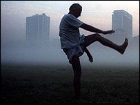 A man exercises against Calcutta smog