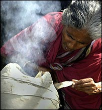 A woman using the traditional smoke