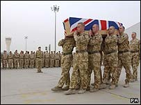 The body of a British solider is carried to a military transport plane in Basra