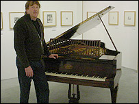 Head of the school of art at Aberystwyth University Robert Meyrick standing at the piano