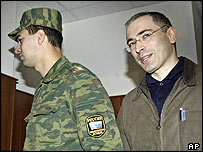 Former Yukos boss Mikhael Khodorkovsky, right, in a Moscow court