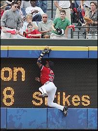 Atlanta Braves' Brian Jordan leaps to catch out Adam Everett