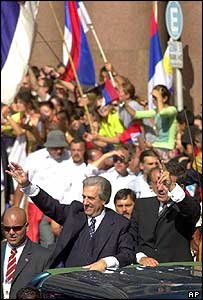 Tabare Vazquez and Vice-President Rodolfo Nin Novoa wave to supporters as they arrive at the Government Palace in Montevideo