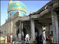 Iraqis check the ruins of the mosque in Hilla that was bombed on 5 October