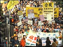 More than 1,000 people march in downtown Hong Kong on Sunday, Jan. 23, 2005, to demand full democracy and social justice in the Chinese territory.