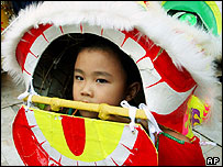 Four-year-old Alex Lu takes part in a Lion Dance for the 2005 Chinese New Year celebrations in Sydney, Australia