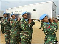 UN troops carry the coffins of nine Bangladeshi peacekeepers killed in DR Congo's Ituri region