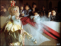Pope Shenouda III spreads incense at Cairo Cathedral during a midnight mass on Coptic Christmas Day
