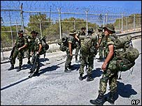 Spanish soldiers at Melilla security fence