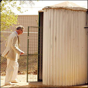 Prince Charles looks at an eco-friendly bush toilet, or dunny