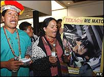 Secoya Indians and environmental activists disrupt a ChevronTexaco news conference in Quito on 2 February