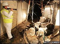 Man surveys home slated for demolition in New Orleans after hurricane