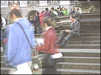 Man using a hotspot at Piccadillly Circus