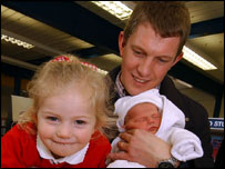 Freya Nichols, aged 4 with dad Stuart Nichols and new born Maisie