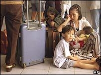An ethnic Chinese family waits to leave the island of Lombok, 2000