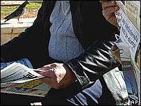 Turkish men reading newspapers
