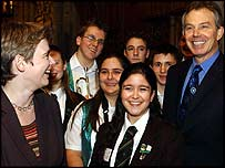 Ruth Kelly and Tony Blair with school children