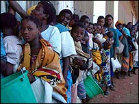 Malawians queue for food