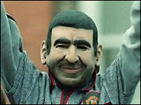 A Manchester United fan wearing an Eric Cantona mask in 1996