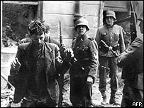 Jewish man arrested by German soliders in Warsaw 1943