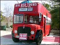 Red British bus for hire as media vantage point