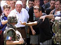 Ethnic Albanian demonstrator confronts a French soldier in Mitrovica, Aug 1999